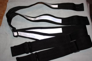 "Heavy Duty Reflective Suspenders 2"" wide suspenders made from 6 oz canvas, and has one inch reflective stripping strip on back. Comes with adjustable strap and loops for belts."